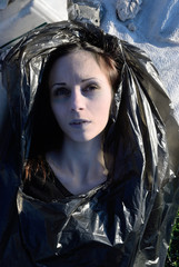 The corpse of a young girl in a garbage bag