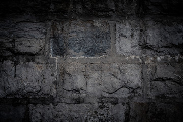Natural stones are folded in wall. Background.