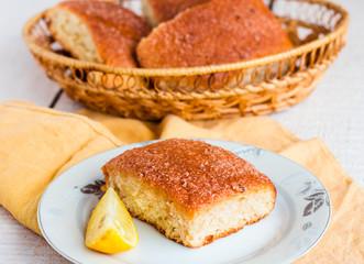 lemon cinnamon rolls on a wooden background