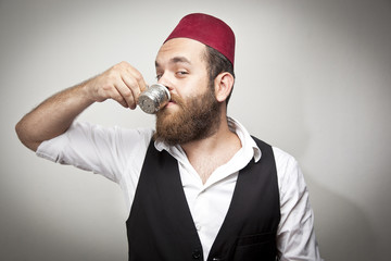 Man in traditional turkish hat and dress kabadayi with coffee