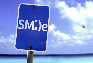 Smile sign with a beach on background