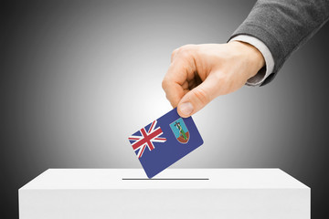 Male inserting flag into ballot box - Montserrat