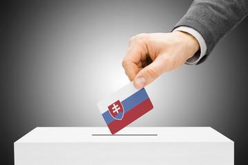 Voting concept - Male inserting flag into ballot box - Slovakia