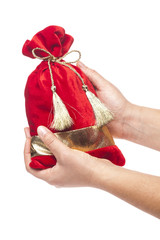 Hand holding bag of gifts isolated on white