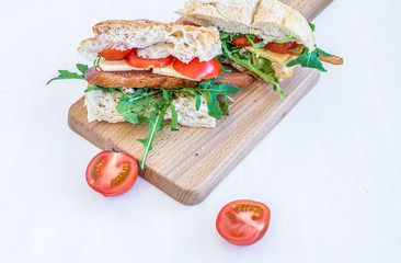 Sandwiches with ccarpaccio, cheese and cherry-tomatoes