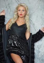 glamorous blonde in a black dress