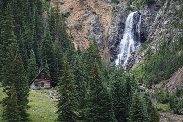 Mountain cabin and waterfall in colorado