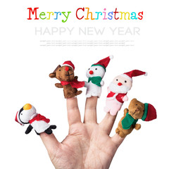 Christmas toys put on a hand on a white background