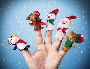 Christmas toys put on a hand