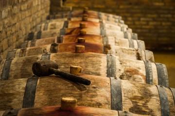 Fototapete - Barrels in Hungarian Wine Cellar with Maul