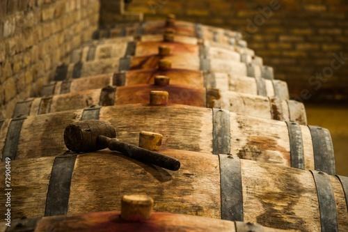 Fototapete Barrels in Hungarian Wine Cellar with Maul