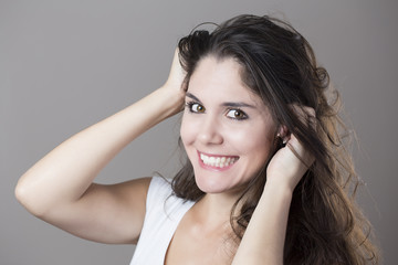 Portrait of a young brunette woman making faces with different e