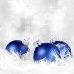 Christmas or holiday background with blue silver ornaments