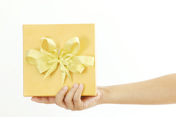 Woman holding a gold gift box