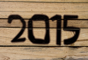 2015 Happy New Year greeting cards, wood burning wood background