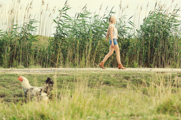 Portrait of young woman walking on the road - rural scene