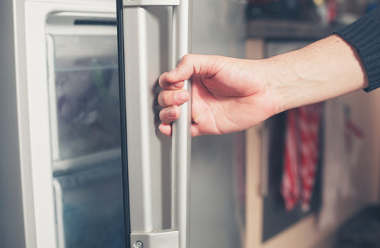 Hand opening freezer door