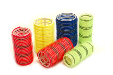 Multicolored hair curlers of different sizes