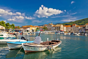 Poster Channel Old wooden boats in Stari Grad