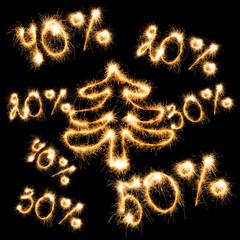Sparkling inscription of 50%, 40%,30%, 20% with christmas tree o