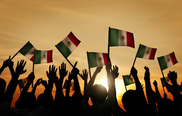 Group of People Waving Mexican Flags