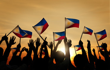 Group of People Waving Filipino Flags