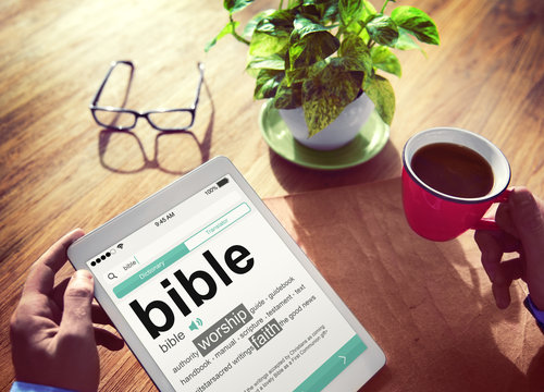 Man Reading the Definition of Bible