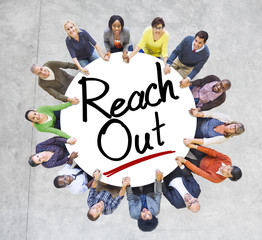 Group of People Holding Hands Around the Word Reach out