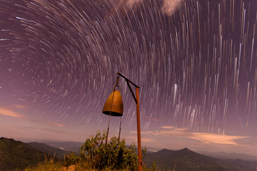 The Stars night of startails rises over the mountain and the bel
