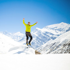 Happy man jumping in mountains