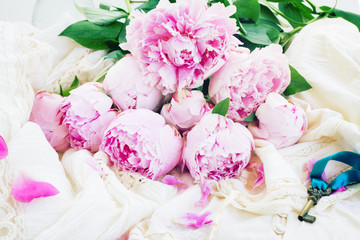 pink peony flowers with key