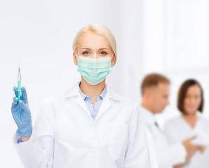 doctor in mask holding syringe with injection