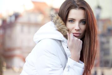 Portrait of the beautiful woman in winter jacket