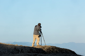 Photographer tacking pictures of the view in Meteora, Greece.