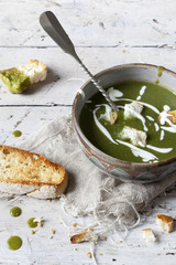 peas and spinach cream soup with sour cream and bread croutons