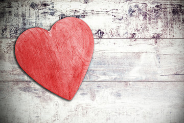 Wooden red heart on timbered background, space for text.