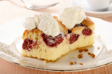 cake with strawberry filling and whipped cream