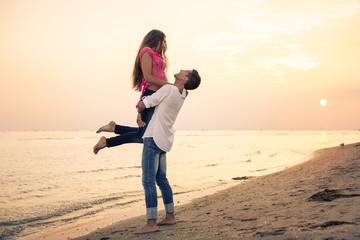 Beautiful Couple having fun on beach
