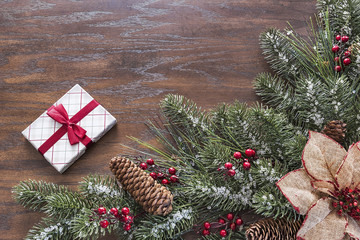 Wood background with Christmas themed pine border