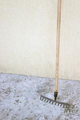 Rake tool over concrete background