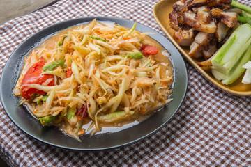 Closeup Thai papaya, charcoal-boiled pork neck,Grill pork (popular food Thailand)