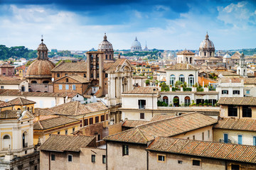 View across the rooftops of Rome and the cupola of St. Peter's