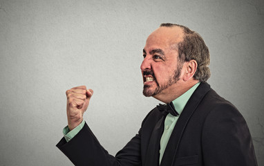 Side view profile portrait angry middle aged man with fist up