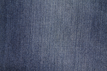 Highly resolution detailed texture of abstract blue denim jeans
