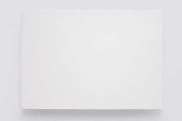 White canvas on stretcher on white wall, clipping path