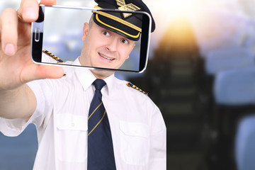 Pilot doing a picture in the aircraft cabin