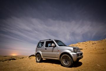 SUV at desert night.