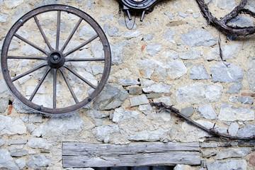 Old house facade with wagon wheel