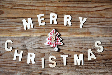 Merry Christmas greeting message with tree on wooden background