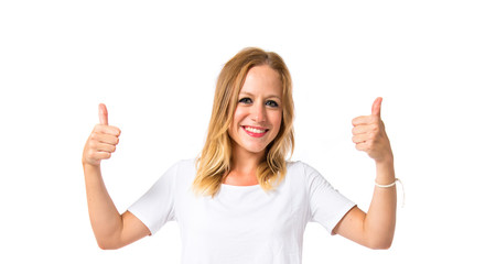 Blonde girl with thumbs up over white background